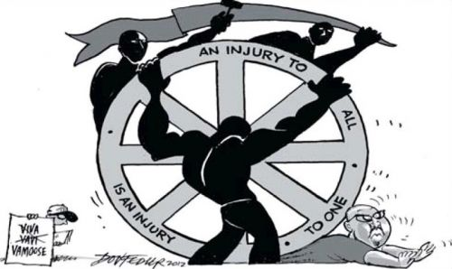 'The Wheel Turns...': Africartoons.com